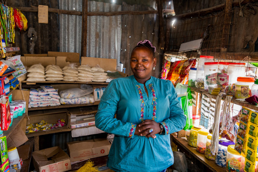 Pictured here is Kanini in front of her shop she opened in 2007 and where she sells household consumables and snacks.