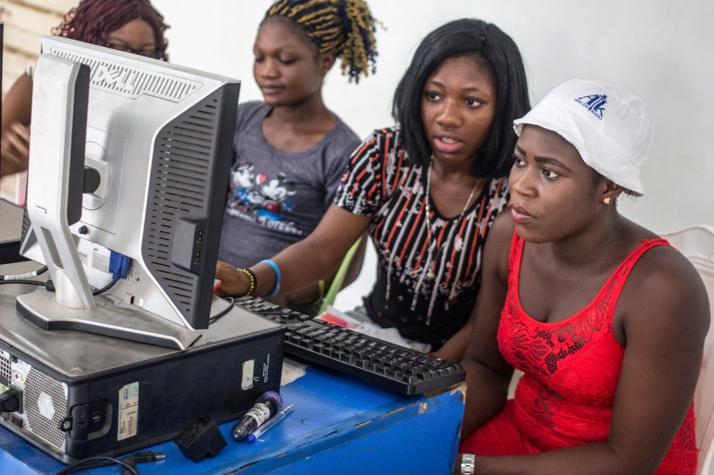 Chiamaka second from the right focused on working her new-found skills on the computer.