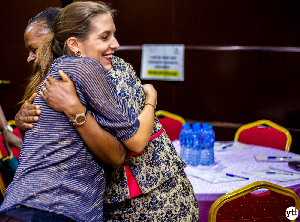 Mastercard employee hugging woman enterpreneur