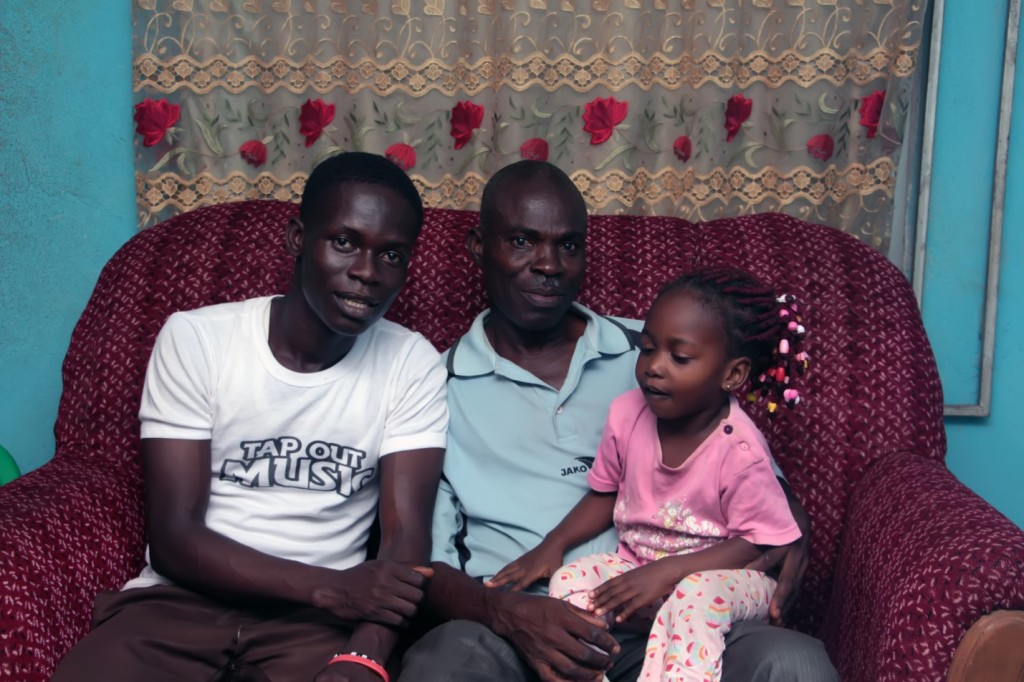 Emmanuel (left) with his father and younger sister.
